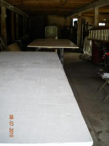 Two coats of primer are put on each side of plywood.  Four coats of primer are put on all edges.