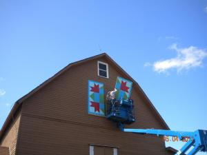 Park District crews install the Barn Quilt – one board at a time.